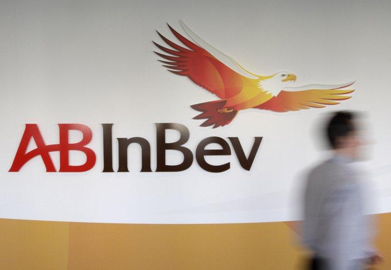 Budweiser brewer sells Australian unit to pay off debt