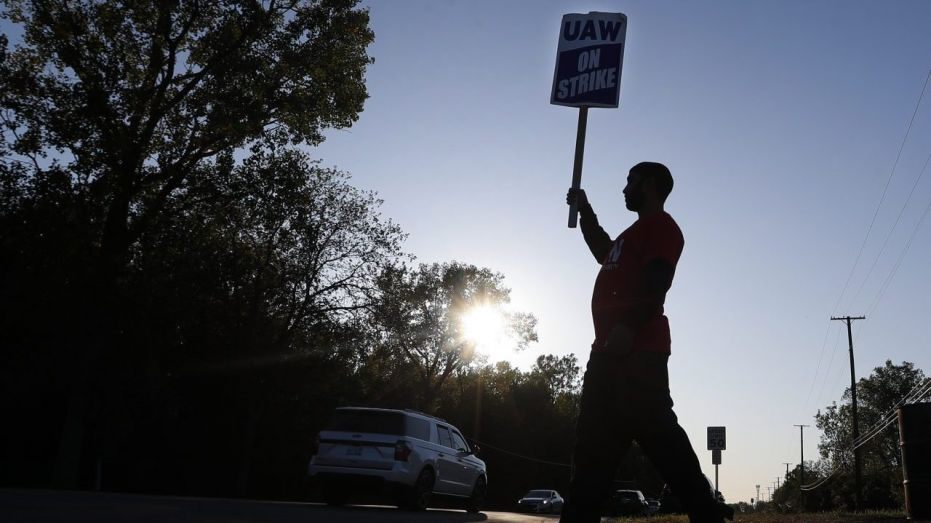 UAW board approves pay increase for striking workers